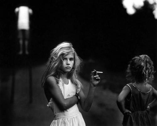 Young Girl Smoking a Cigarette