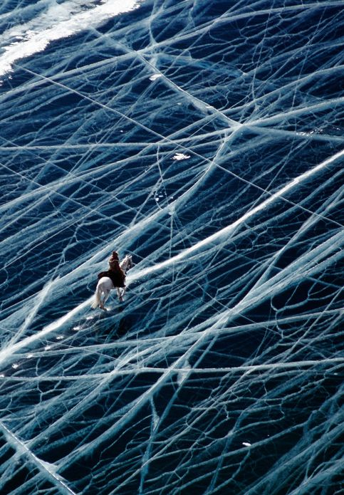 riding a horse in siberia on top of the ice
