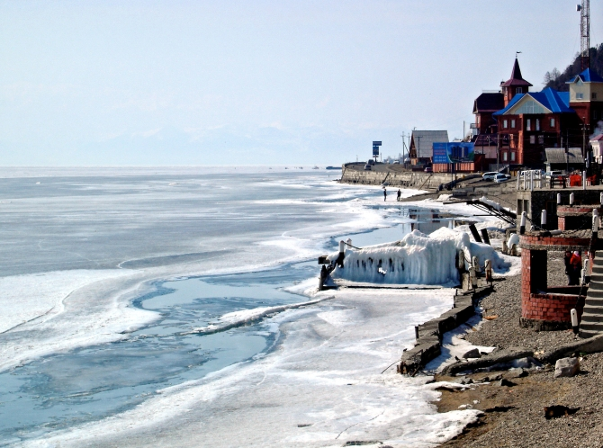 Frozen waters of lake Baikal and its shore