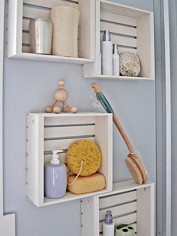 Reused old wooden boxes for bathroom shelves