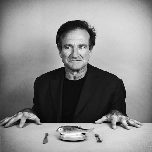 Robin williams black and whit portrait with a fish