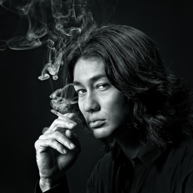 black and whit portrait of woman smoking cigarette by yaman ibrahim