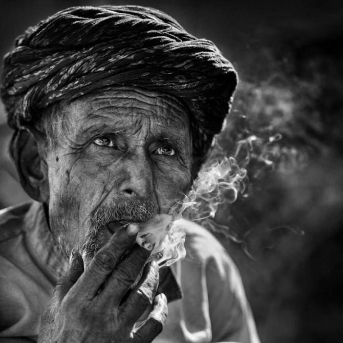 portrait of an old man smoking cigarette by yaman ibrahim