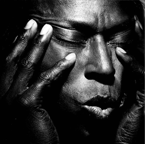 black and white portrait of miles davis by irving penn